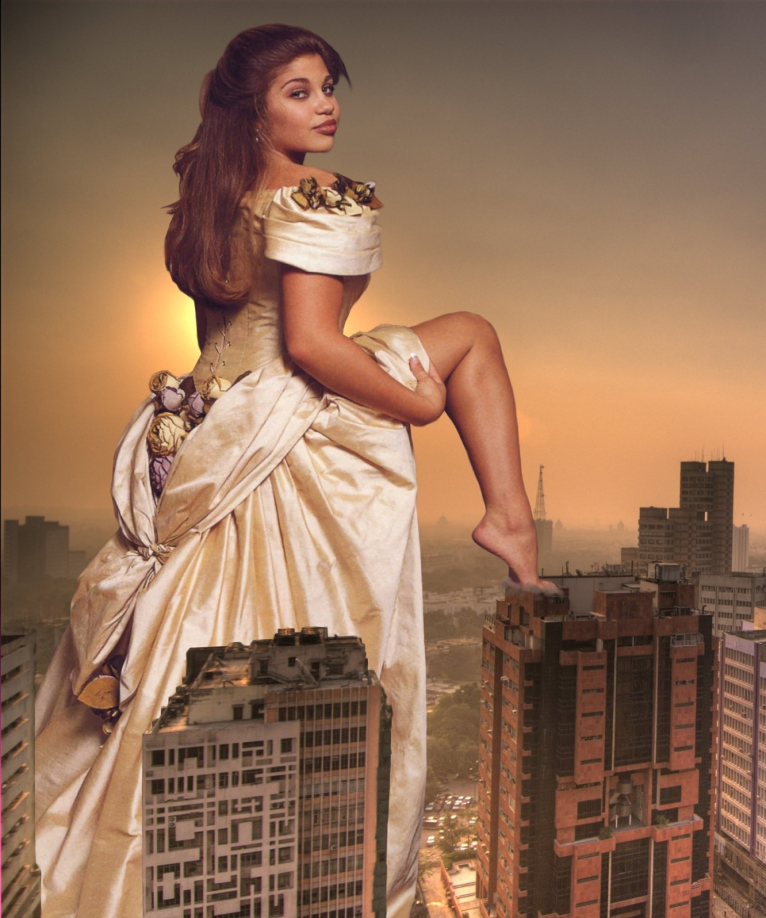 Young woman in bridal gown stands taller than buildings.