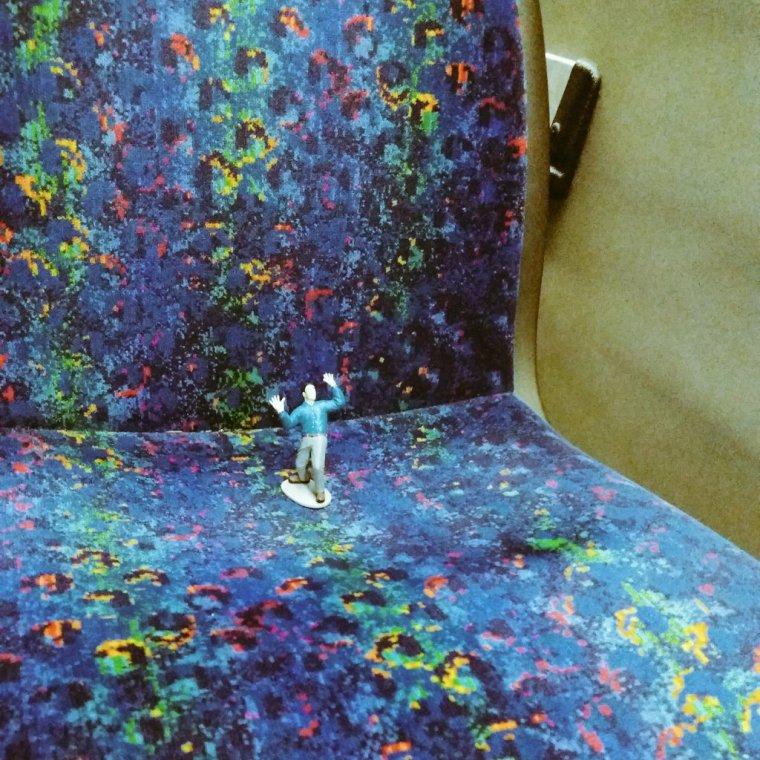 tiny man on bus seat
