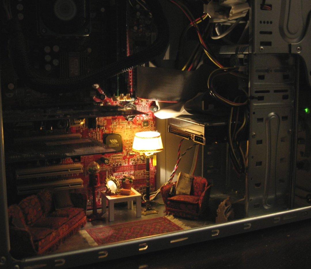 A cozy living room setting built into a computer case.